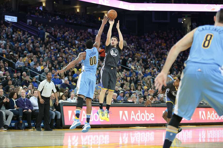 Golden State Warriors guard Klay Thompson (11) takes a shot against Denver Nuggets forward Darrell Arthur (00) during the first half of an NBA basketball game, Saturday, Jan. 2, 2016, at Oracle Arena in Oakland, Calif. Photo: Santiago Mejia, Special To The Chronicle