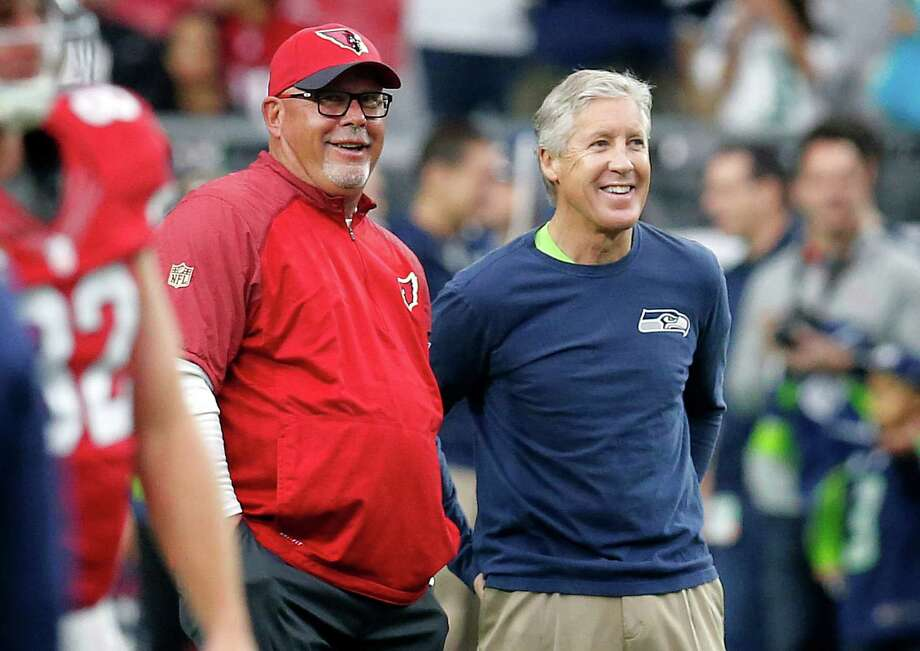 Arizona Cardinals head coach Bruce Arians, left, talks with Seattle Seahawks head coach Pete Carroll prior to an NFL football game, Sunday, Jan. 3, 2016, in Glendale, Ariz. (AP Photo/Rick Scuteri) Photo: Rick Scuteri, Associated Press / FR157181 AP