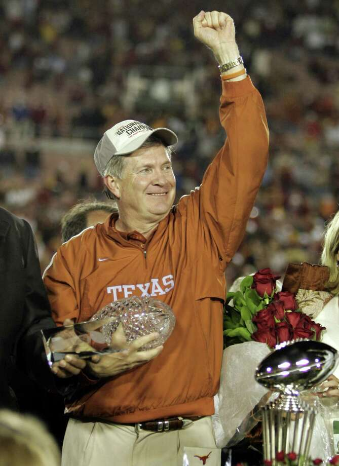 FILE - In  this Jan. 4, 2006, file photo, Texas head coach Mack Brown celebrates with the championship trophy after Texas beat Southern California 41-38 in the Rose Bowl, the national championship college football game in Pasadena, Calif. Brown has stepped down as coach and that the Alamo Bowl against Oregon on Dec. 30 will be his last game with the Longhorns, the school announced Saturday, Dec. 14, 2013. (AP Photo/ Mark J. Terrill, File) Photo: MARK J. TERRILL, STF / Associated Press / AP