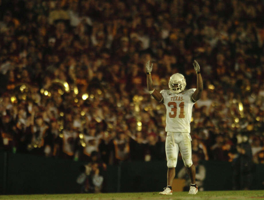 Texas Longhorns cornerback Aaron Ross asks for crowd support during Rose Bowl action against USC in the Rose Bowl on Jan. 4, 2006. BILLY CALZADA / STAFF