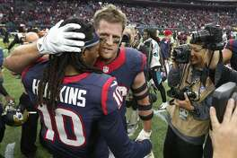 Houston Texans defensive end J.J. Watt (99) hugs DeAndre Hopkins (10) after the Texans beat the Jacksonville Jaguars 30-6 after an NFL football game at NRG Stadium on Sunday, Jan. 3, 2016, in Houston. ( Karen Warren / Houston Chronicle )