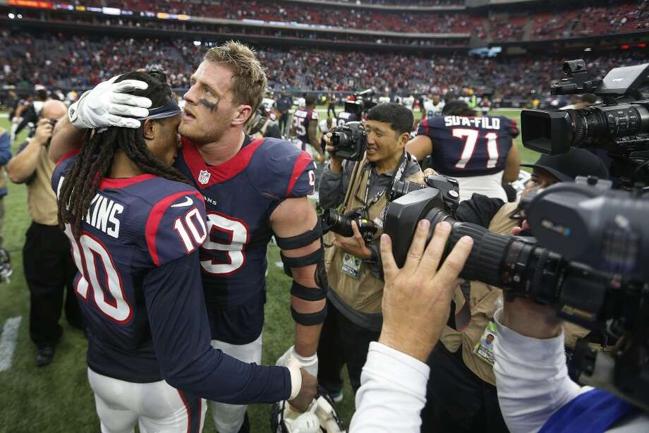 PHOTOS: How players reacted to the DeAndre Hopkins trade when it happened in March Houston Texans defensive end J.J. Watt (99) hugs DeAndre Hopkins (10) after the Texans beat the Jacksonville Jaguars 30-6 after an NFL football game at NRG Stadium on Sunday, Jan. 3, 2016, in Houston. ( Karen Warren / Houston Chronicle ) Photo: Karen Warren, Houston Chronicle