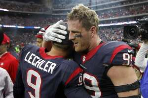 Houston Texans defensive end J.J. Watt (99) hugs punter Shane Lechler (9) after the Texans beat the Jacksonville Jaguars 30-6 after an NFL football game at NRG Stadium on Sunday, Jan. 3, 2016, in Houston.  ( Karen Warren / Houston Chronicle )