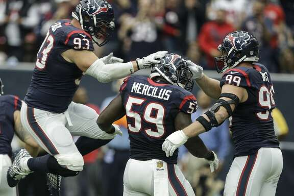 Houston Texans defensive end Jared Crick (93), outside linebacker Whitney Mercilus (59) and defensive end J.J. Watt (99) celebrate after Mercilus sacked Jacksonville Jaguars quarterback Blake Bortles during the first quarter of an NFL football game at NRG Stadium on Sunday, Jan. 3, 2016, in Houston. ( Brett Coomer / Houston Chronicle )