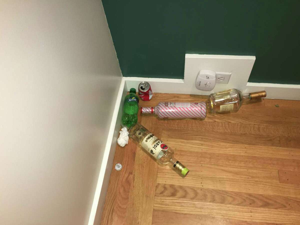 Alcohol bottles, soda cans and more litter the home of Jim Santi Owen and Reshma Vasanwala.