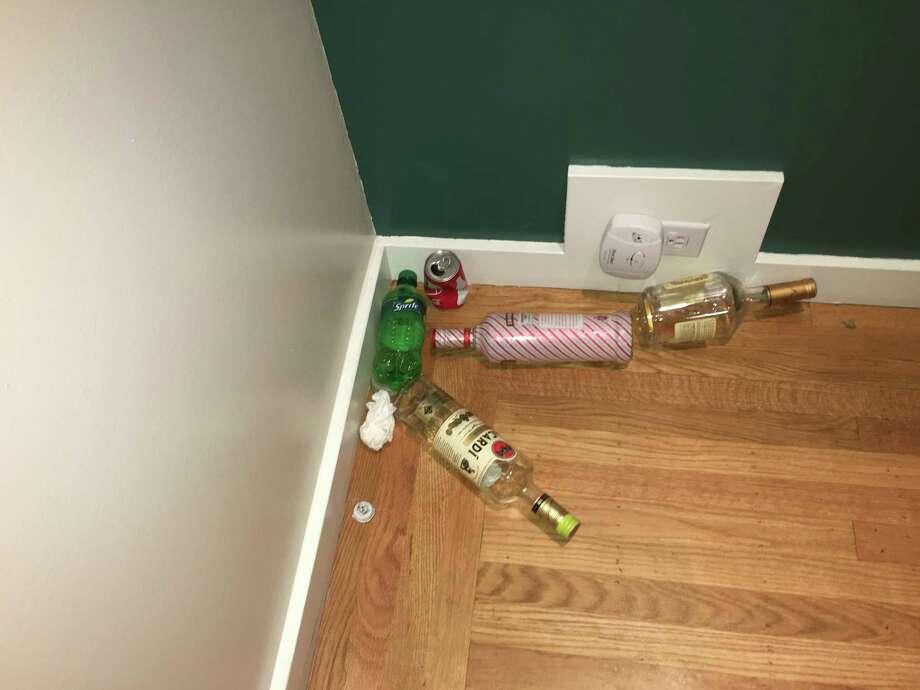Alcohol bottles, soda cans and more litter the home of Jim Santi Owen and Reshma Vasanwala. Photo: Jim Santi Owen