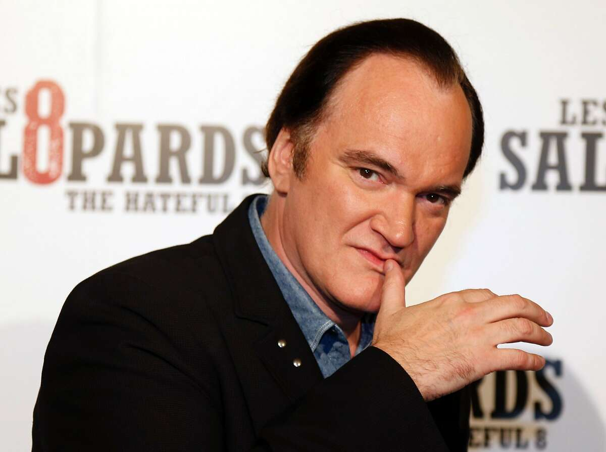 """(FILES) This file photo taken on December 11, 2015 shows US director Quentin Tarantino posing during a photocall for the premiere of his latest movie """"The Hateful Eight"""" (Les Huit Salopards) in Paris on December 11, 2015. American director Quentin Tarantino's new film, """"The Hateful Eight"""", the violent story of eight men with troubled pasts confined together in an inn, will be released on January 6. / AFP / FRANCOIS GUILLOTFRANCOIS GUILLOT/AFP/Getty Images"""