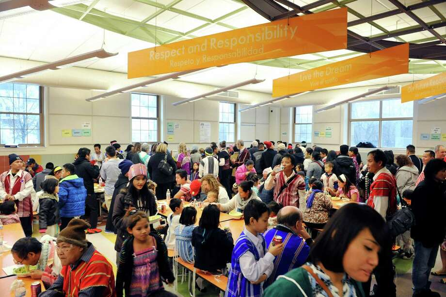 Members of the Karen community and guests visit with each other as they enjoy lunch during a Karen New Year celebration on Sunday, Jan. 3, 2016, in Albany, N.Y.    (Paul Buckowski / Times Union) Photo: PAUL BUCKOWSKI / 10034834A
