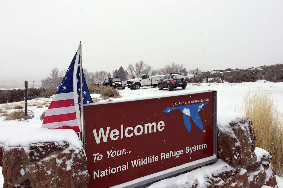 An sign of the National Wildlife Refuge System is seen at an entry of the wildlife refuge about 30 miles southeast of Burns, Ore., Sunday, Jan. 3, 2016. Armed protesters are occupying a building at the national wildlife refuge and asking militia members around the country to join them. The protesters went to Malheur National Wildlife Refuge on Saturday following a peaceful rally in support of two Oregon ranchers facing additional prison time for arson. (Les Zaitz/The Oregonian via AP) MANDATORY CREDIT Photo: Les Zaitz, MBI / Associated Press / The Oregonian
