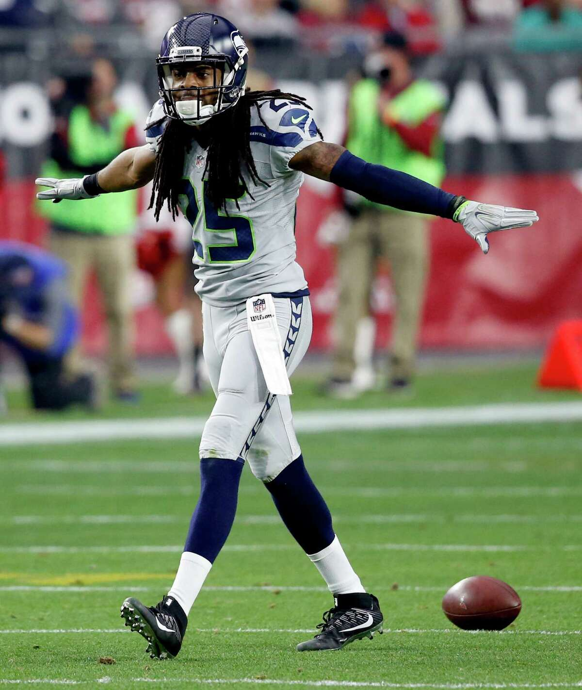 Seattle Seahawks cornerback Richard Sherman (25) celebrates a stop against the Arizona Cardinals during the first half of an NFL football game, Sunday, Jan. 3, 2016, in Glendale, Ariz. (AP Photo/Ross D. Franklin)