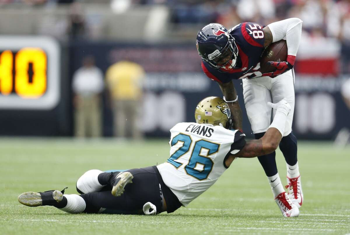 Houston Texans wide receiver Nate Washington (85) is brought down after a gain by Jacksonville Jaguars free safety Josh Evans (26) during the first quarter of an NFL football game at NRG Stadium on Sunday, Jan. 3, 2016, in Houston. ( Karen Warren / Houston Chronicle )