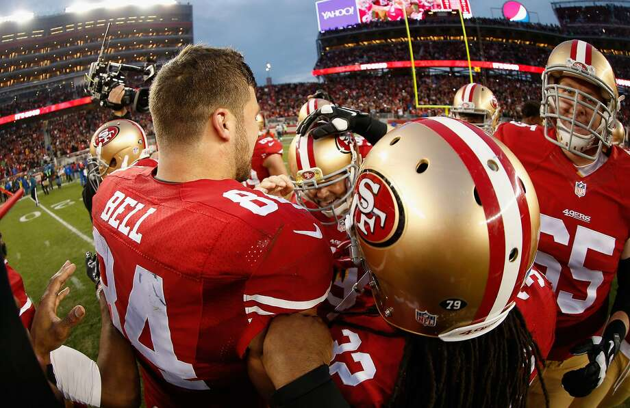 Phil Dawson #9 of the San Francisco 49ers is congratulated by teammates after he kicked a game-winning field goal in overtime of their game against the St. Louis Rams at Levi's Stadium on January 3, 2016 in Santa Clara, California.  Photo: Ezra Shaw, Getty Images