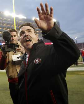 San Francisco 49ers' head coach Jim Tomsula waves to the crowd after Niners' 19-16 win in overtime over St. Louis Rams in NFL game at Levi's Stadium in Santa Clara, Calif., on Sunday, January 3, 2016.