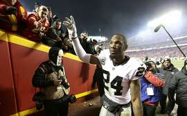 Oakland Raiders free safety Charles Woodson (24) waves to fans as he walks off the field after an NFL football game against the Kansas City Chiefs, Sunday, Jan. 3, 2016, in Kansas City, Mo. The Chiefs won 23-17. (AP Photo/Charlie Riedel)