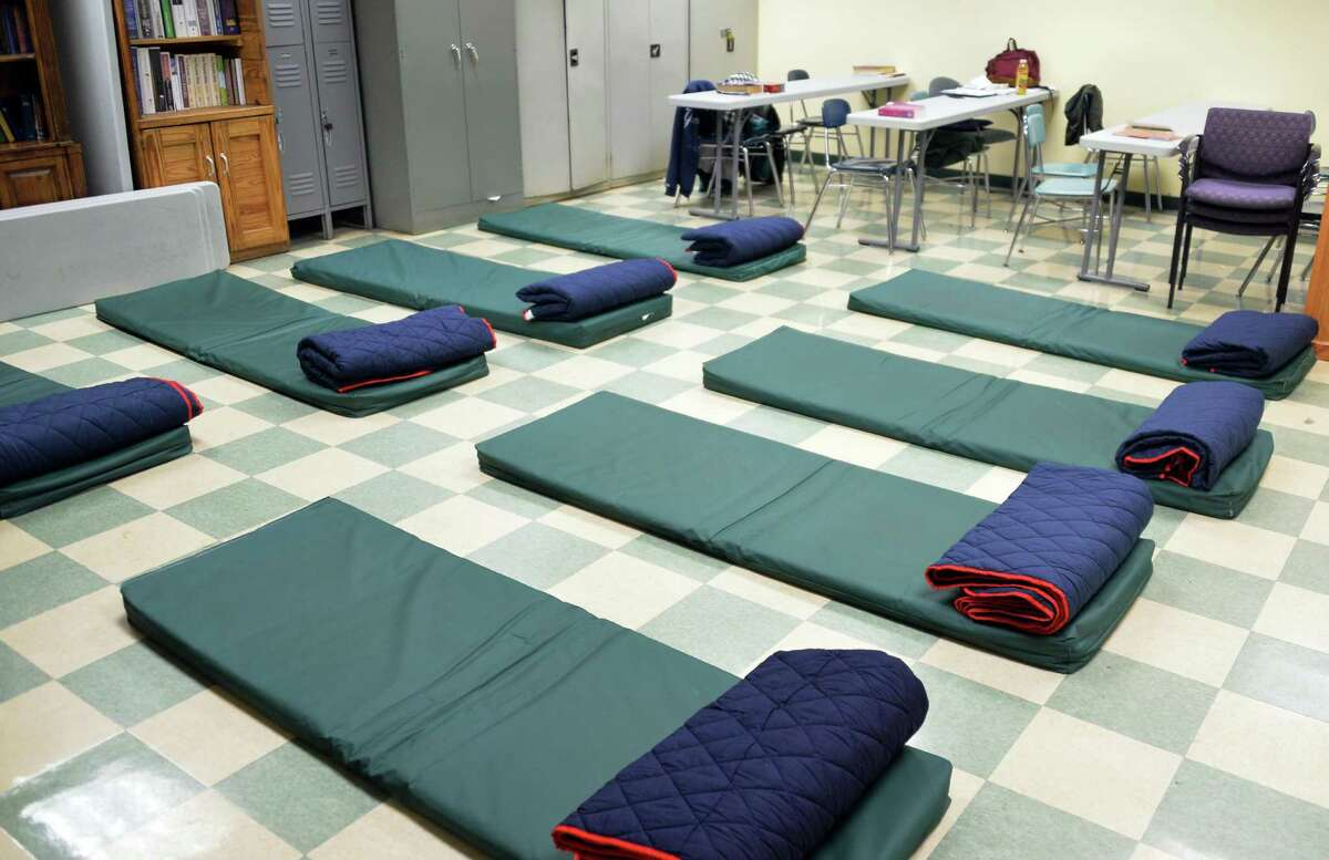 A classroom at Capital City Rescue Mission is converted to temporary sleeping quarters for tonight's code blue Friday Nov. 28, 2014, in Albany, NY. Code Blue is a walk-in, emergency homeless shelter that offers a hot meal and a warm and safe place to sleep when temperatures are below 20 degrees or there is significant snowfall. (John Carl D'Annibale / Times Union)