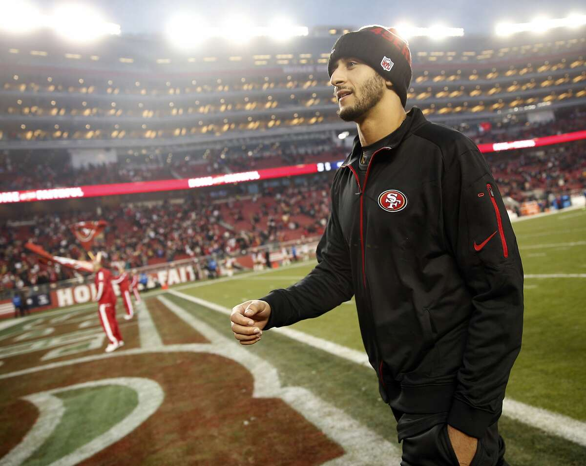 San Francisco 49ers' Colin Kaepernick walks off the field following Niners' 19-16 win over St. Louis Rams in overtime in NFL game at Levi's Stadium in Santa Clara, Calif., on Sunday, January 3, 2016.