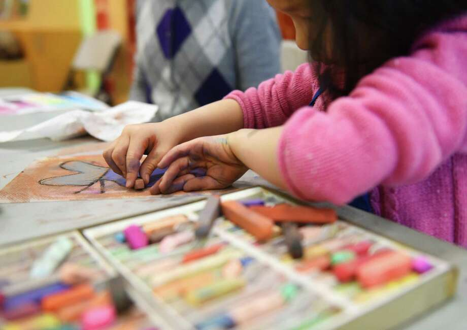 Youhan Liang, 6, of Greenwich, gets her hands messy while working on a piece during the Drawing with Pastels Family Studio Workshop at Bruce Museum in Greenwich, Conn. Sunday, Jan. 3, 2016.  In this class, students learned pastel techniques by practicing on a variety of still life objects in the studio.  The Museum regularly holds drop-in family workshops that allow curious and creative kids to explore the process of making fine art and discuss current exhibitions.  The next Family Studio Workshop is Mixed Media Self-Portraits on Jan. 24. Photo: Tyler Sizemore / Hearst Connecticut Media / Greenwich Time