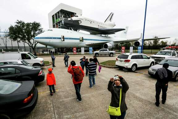 The original NASA 905 shuttle carrier aircraft and a replica of the Independence shuttle at Independence Plaza draw a crowd in the parking lot at Space Center Houston. The new exhibit will open to the public on Jan. 23.