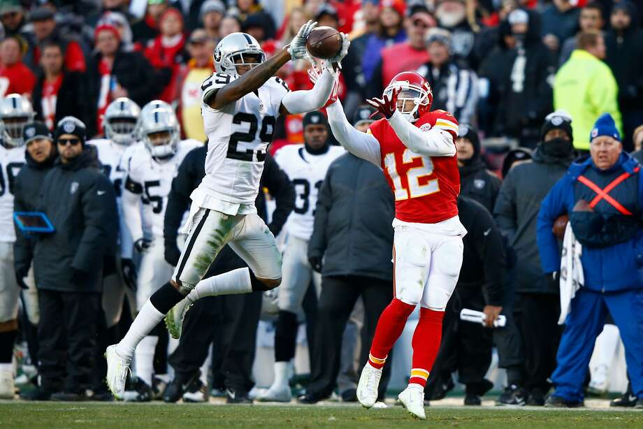 KANSAS CITY, MO - JANUARY 3:  David Amerson #29 of the Oakland Raiders intercepts a pass in front of Albert Wilson #12 of the Kansas City Chiefs, returning it for a touchdown at Arrowhead Stadium during the second quarter on January 3, 2016 in Kansas City, Missouri. (Photo by Jamie Squire/Getty Images) Photo: Jamie Squire, Getty Images