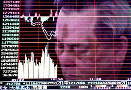 A man is reflected on a monitor screen displaying stock index at a brokerage house in Handan in north China's Hebei province, Monday, Jan. 4, 2016. Shanghai's stock index plunged nearly 7 percent on Monday, sparking a halt in trading of Chinese shares, after weak manufacturing data and Middle East tensions weighed on Asian markets. (Chinatopix via AP) CHINA OUT