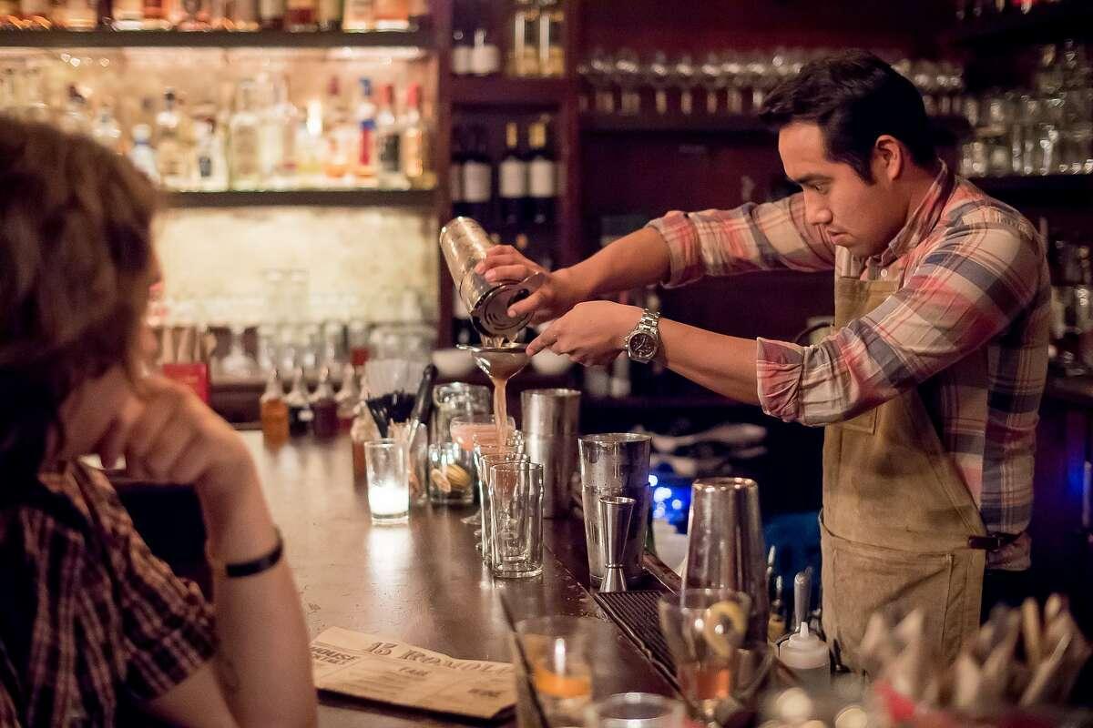 Bartender Daniel Godinez strains a drink at 15 Romolo in San Francisco, Calif., on January 2nd, 2016.