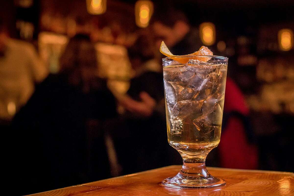 A Miraculous Milk Punch, $13, made with rum, brandy, green cardamom, nutmeg and clarified milk.