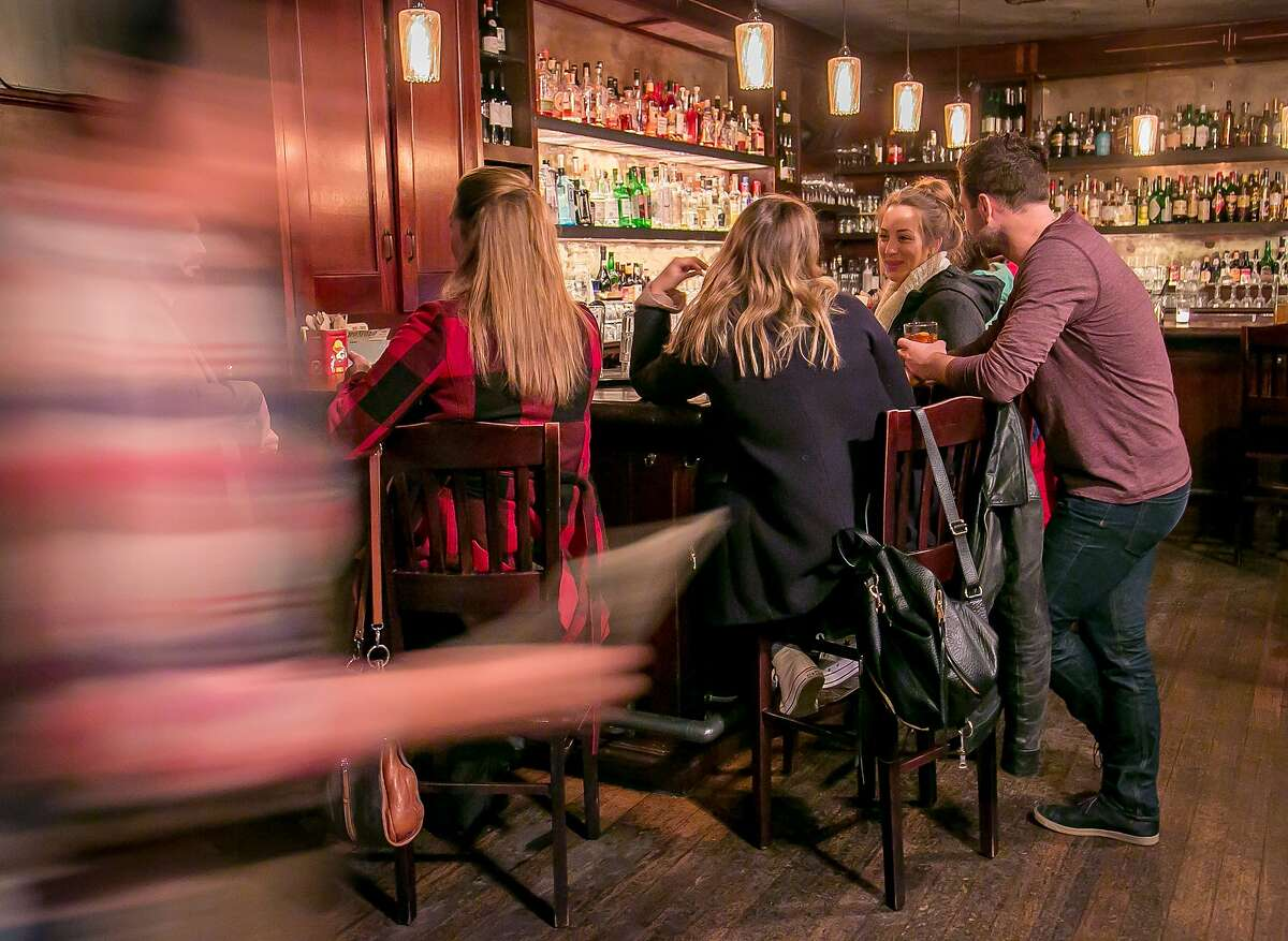 People have drinks at 15 Romolo in San Francisco, Calif., on January 2nd, 2016.