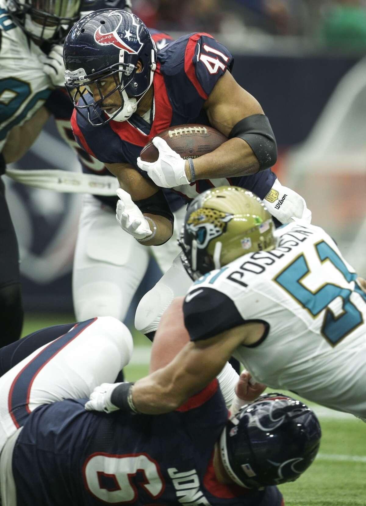Houston Texans running back Jonathan Grimes (41) runs past Jacksonville Jaguars middle linebacker Paul Posluszny (51) for a 3-yard touchdown run during the second quarter of an NFL football game at NRG Stadium on Sunday, Jan. 3, 2016, in Houston. ( Brett Coomer / Houston Chronicle )