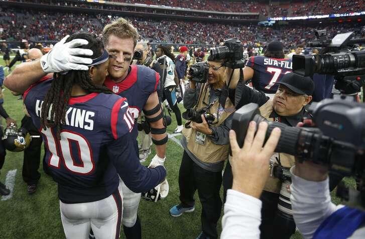 Houston Texans defensive end J.J. Watt (99) hugs DeAndre Hopkins (10) after the Texans beat the Jacksonville Jaguars 30-6 after an NFL football game at NRG Stadium on Sunday, Jan. 3, 2016, in Houston.  ( Karen Warren / Houston Chronicle )