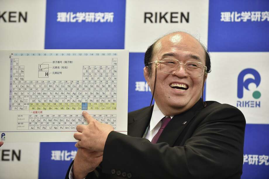 Kosuke Morita, the leader of the Riken team, smiles as he points to a board displaying the new atomic element 113 during a press conference in Wako, Saitama prefecture on December 31, 2015.  A Japanese research team has received naming rights for new atomic element 113, the first on the periodic chart to be named by Asian scientists, the team's institute said December 31.  Photo: KAZUHIRO NOGI,  KAZUHIRO NOGI/AFP/Getty  / AFP