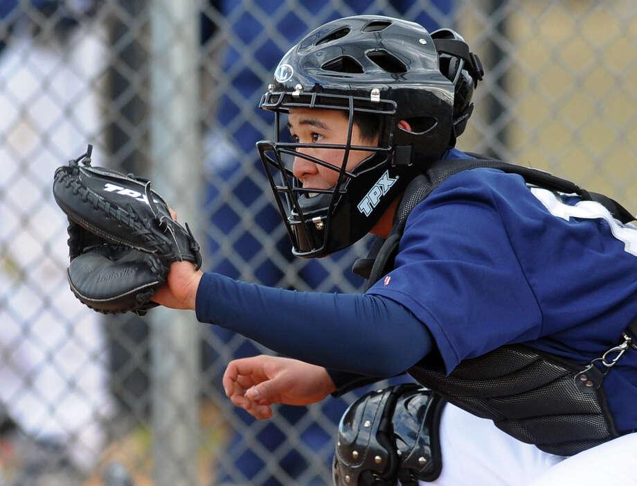 Staples catcher Noah Yokoi, during boys baseball action against Fairfield Warde in Fairfield, Conn. on Tuesday March 26, 2013. Photo: Christian Abraham / Christian Abraham / Connecticut Post
