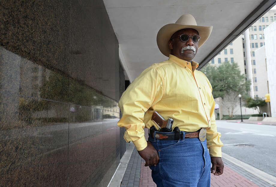 The new year brought with it the start of a new state law permitting open carry of firearms. Josey Johnson, III, is among the gun owners who will openly carry his pistol where permitted.   Photo taken Saturday, January 2, 2016  Kim Brent/The Enterprise Photo: Kim Brent / Beaumont Enterprise