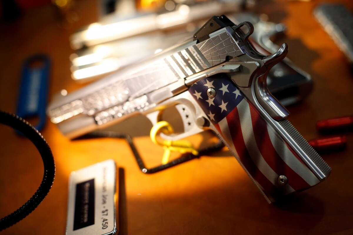 1. Are you buying the gun for yourself, or is it actually for someone else? A decorative pistol is seen, during a 2013 NRA meeting in Houston at the George R Brown convention center. (TODD SPOTH FOR THE CHRONICLE)