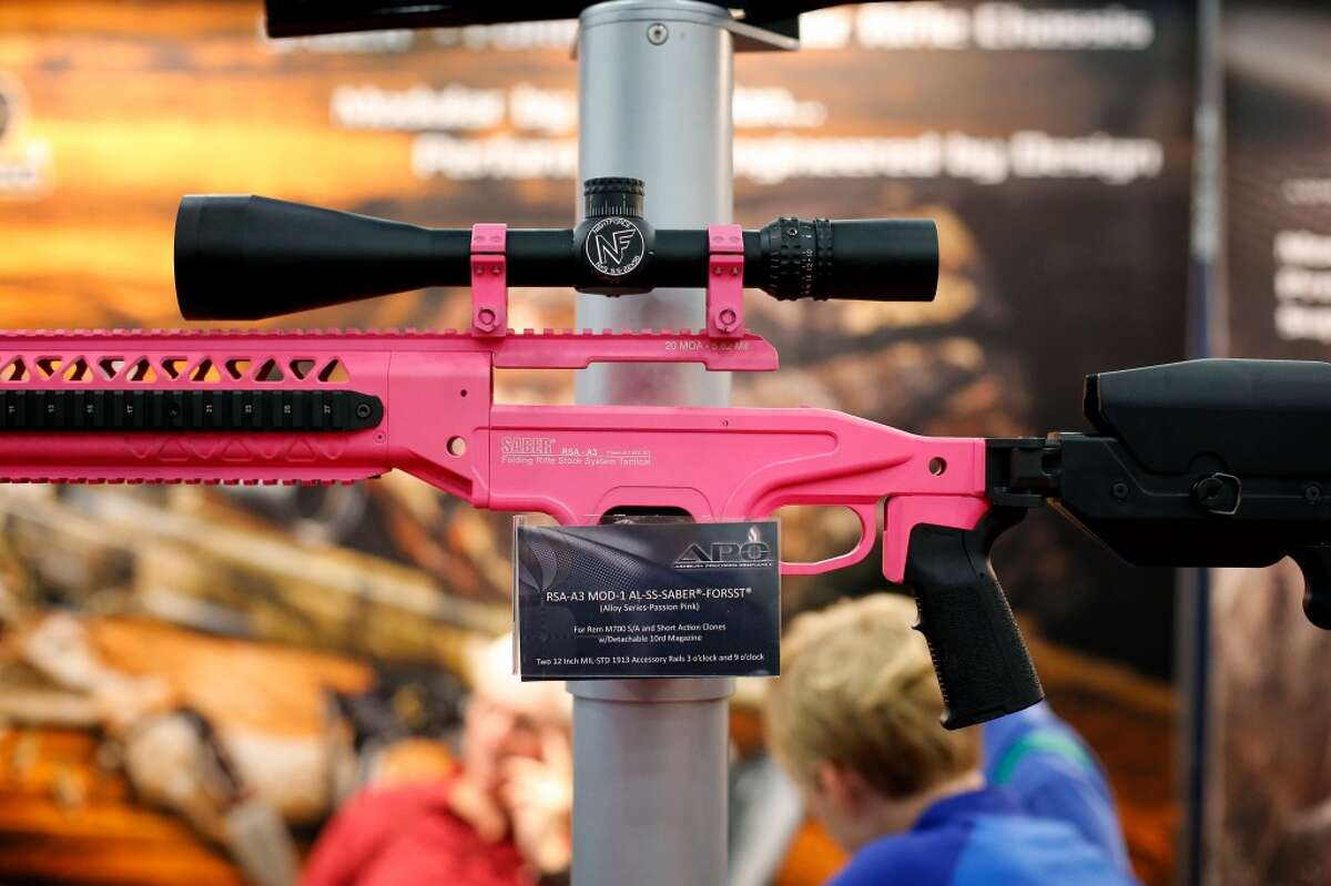 2. Are you currently charged with a crime that could land you in jail for more than a year? A decorative rifle is seen, during a 2013 NRA meeting in Houston at the George R Brown convention center. (TODD SPOTH FOR THE CHRONICLE)
