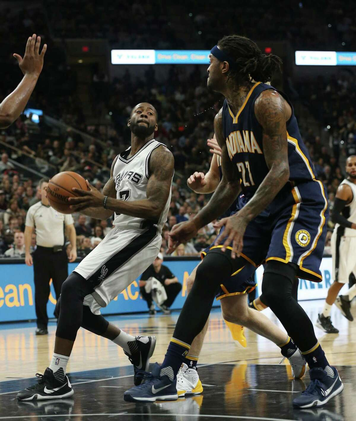 San Antonio Spurs' Jonathon Simmons looks to pass the ball as Indiana Pacers' Jordan Hill defends during the second half at the AT&T Center, Monday, Dec. 21, 2015. The Spurs won, 106-92.