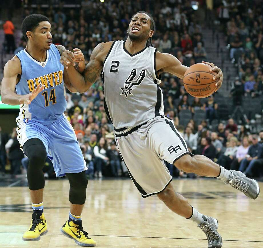 Kawhi Leonard tries a Manu style bump against Gary Harris as the Spurs host the Denver Nuggets at the AT&T Center on December 27, 2015. Photo: TOM REEL, STAFF / SAN ANTONIO EXPRESS-NEWS / 2015 SAN ANTONIO EXPRESS-NEWS