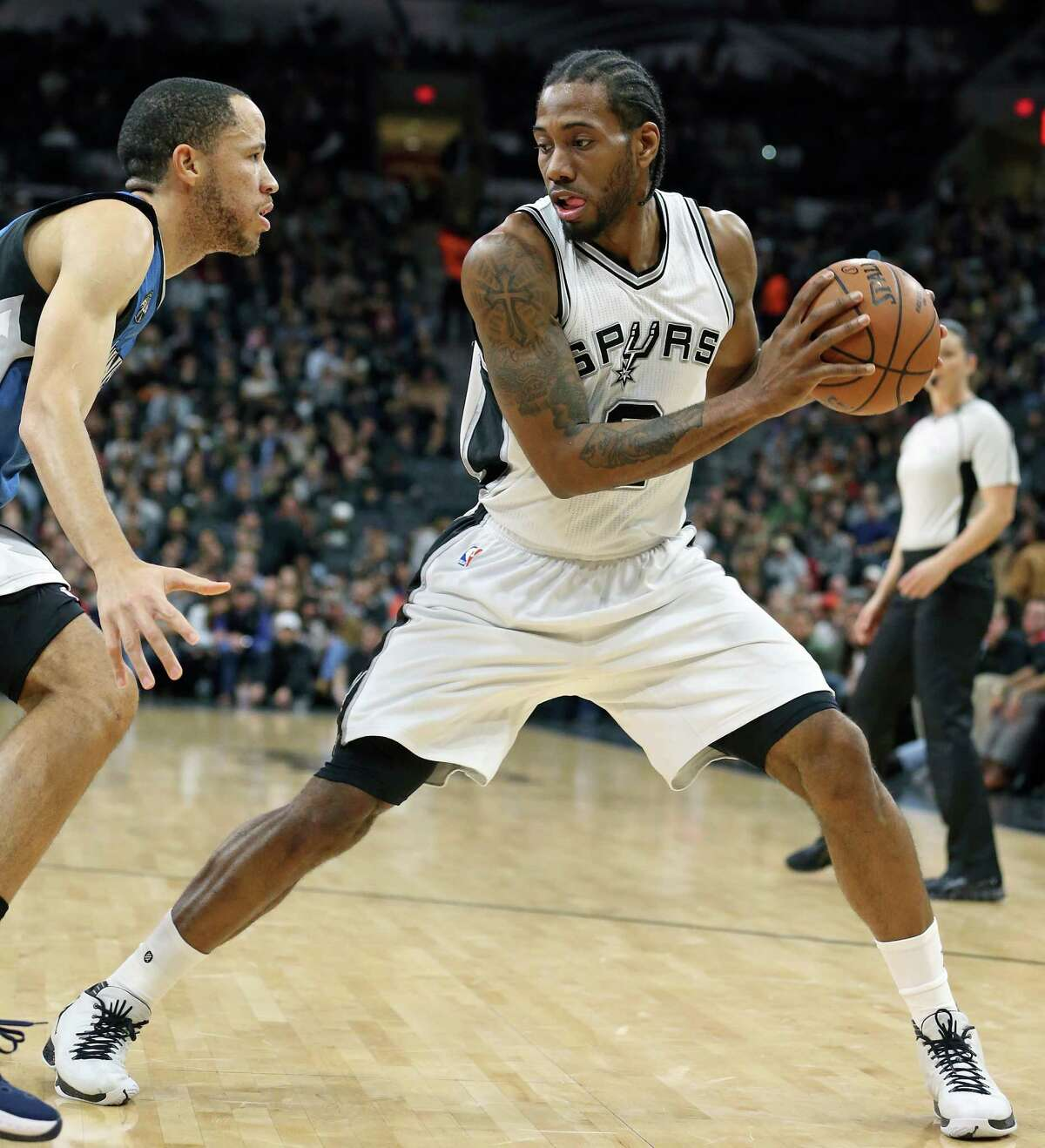 Kawhi Leonard tests Tayshaun Prince on the wing as the Spurs host the Minnesota Timberwolves at the AT&T Center on December 28, 2015.