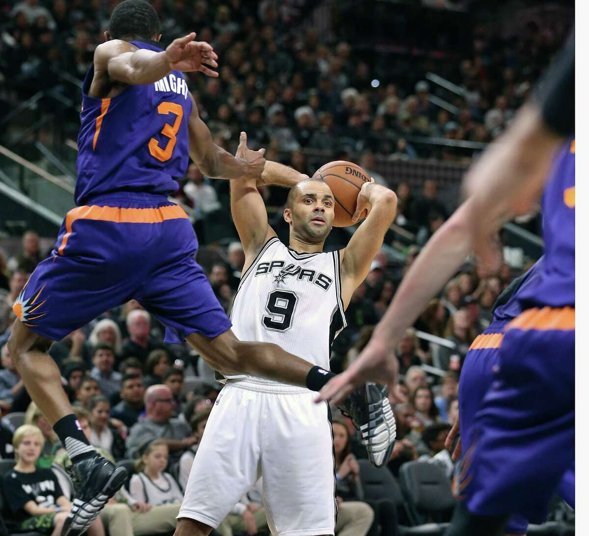 Tony Parker sends Brandon Knight flying as the Spurs host the Suns at the AT&T Center on December 30, 2015.