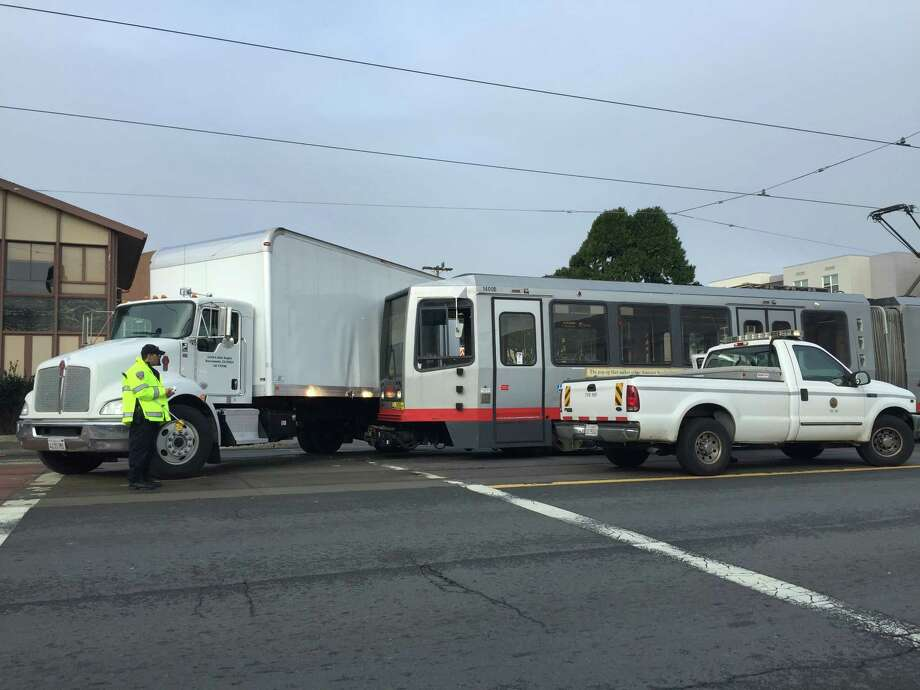 A Muni train and a box truck collided Monday morning in San Francisco's Bayview. Five people, including a child, had minor injuries. Photo: Kimberly Veklerov / /