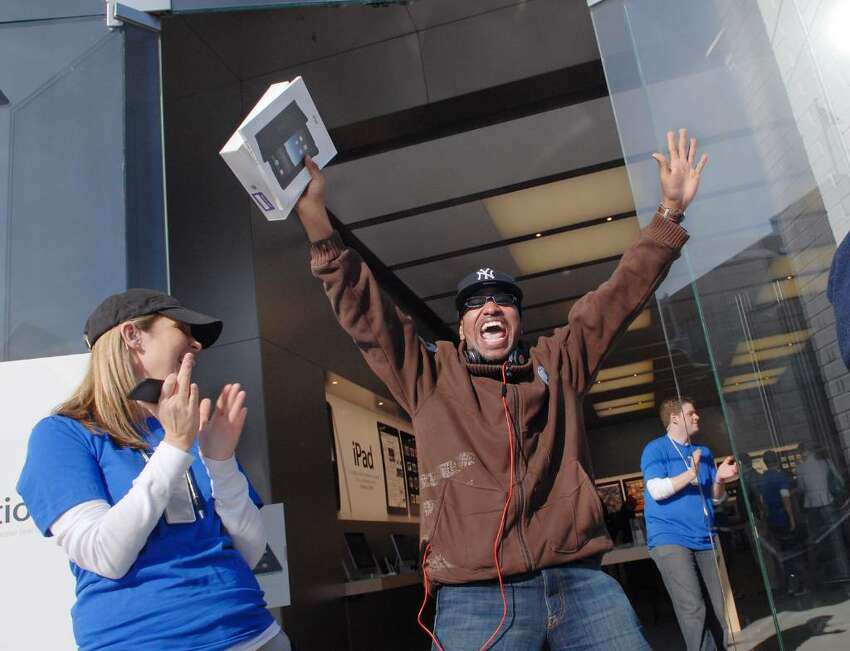 Carlos Suarez of Rye, NY, reacts with a shout as he leaves the Apple store on Greenwich Ave. after purchasing an iPad Saturday morning, April 3rd, 2010, Greenwich, Conn.