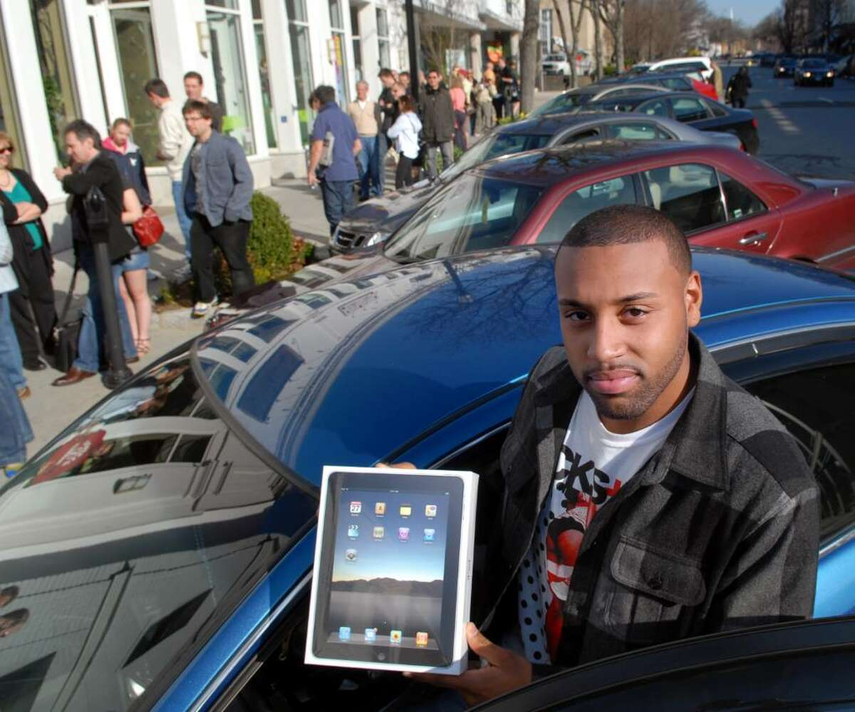 Shawn Mendenhall of Bridgeport, Conn., displays the box of his new iPad in front of the Apple store on Greenwich Ave., Saturday morning, April 3rd, 2010. Mendenhall said he was the second person in line at the store and that to get that position, he slept in his car in front of the store since 3am Saturday morning.