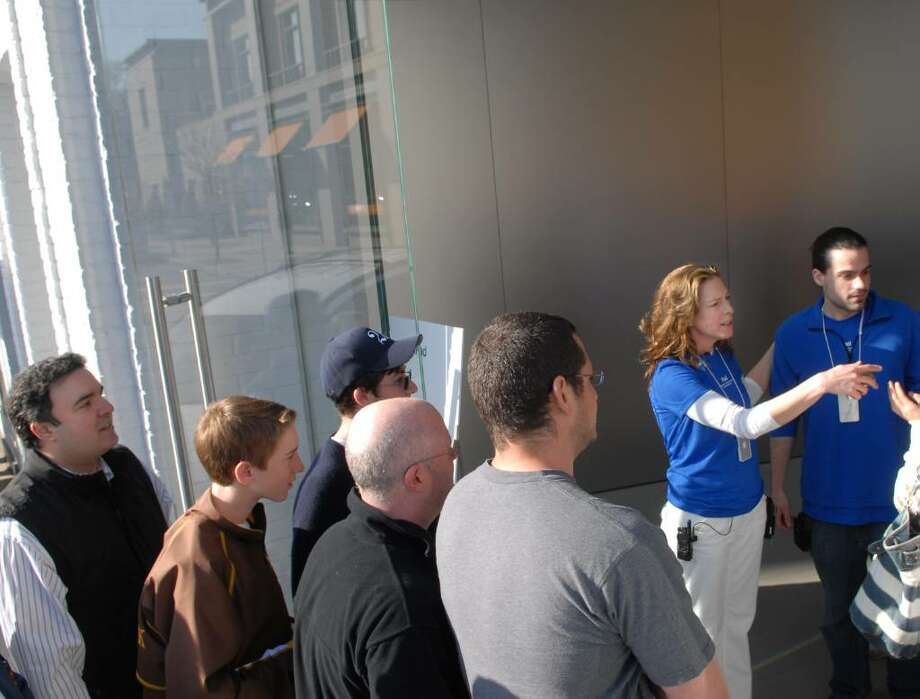 The Apple faithful who had reservations to be first to get into the Apple store for an iPad, are let into the  store on Greenwich Ave., Saturday morning at 9am, April 3rd, 2010. Photo: Bob Luckey / Greenwich Time