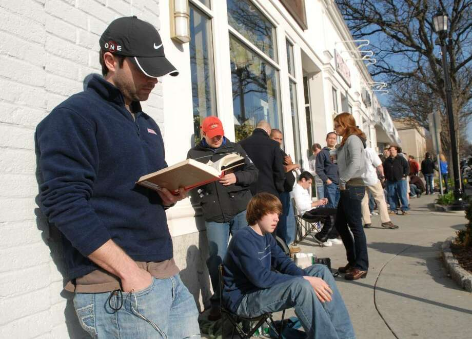 Brendan Ahearn of Rye, NY, is one of a few hundred people who waited  in line in front of the Appple store on Greenwich Ave., Saturday morning, April 3rd, during the launch of Apple's new mobile computing device called the iPad. Photo: Bob Luckey / Greenwich Time