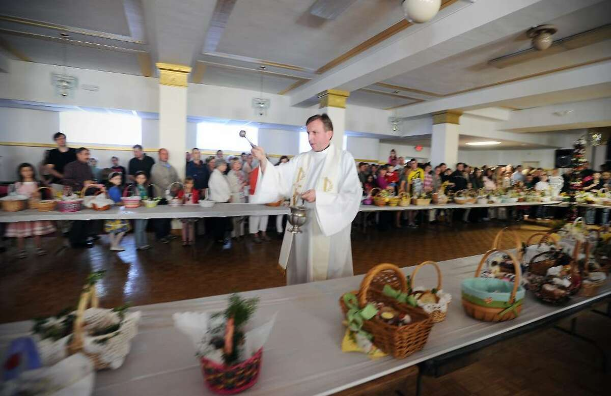 Rev. Eugene Kotlinski performs the traditional Easter blessing of the food at Holy Name of Jesus Church in Stamford, Conn. on Saturday April 3, 2010