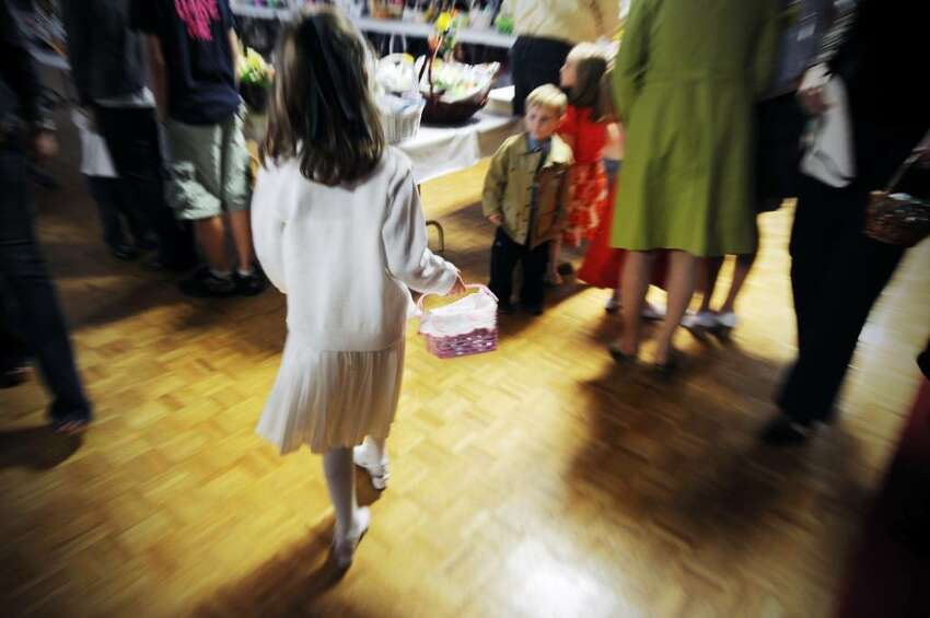 Children arrive with their baskets for the traditional Easter blessing of the food at Holy Name of Jesus Church in Stamford, Conn. on Saturday April 3, 2010
