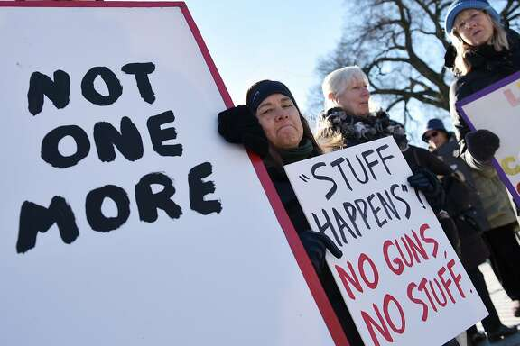 Demonstrators take part in a rally to demand sensible gun laws in front of the White House on January 4, 2016 in Washington, DC. US President Barack Obama is expected to announce executive action to expand background checks on gun sales before his State of the Union address on January 12. AFP PHOTO/MANDEL NGANMANDEL NGAN/AFP/Getty Images