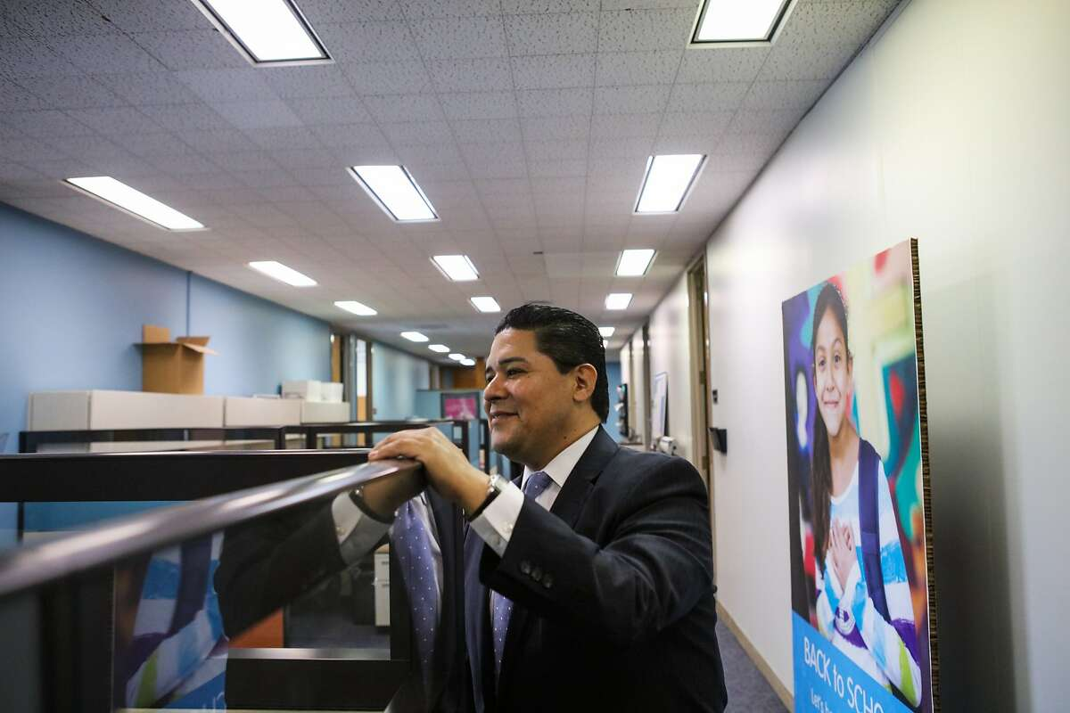 San Francisco's superintendent, Richard Carranza speaks with colleague Myong Leigh (not pictured) at his office in San Francisco, California on Monday, January 4, 2016.