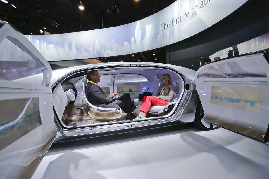 FILE - In this January 2015 file photo, attendees sit in the self-driving Mercedes-Benz F 015 concept car at the Mercedes-Benz booth at the International CES, in Las Vegas. Everything we buy or use these days has the potential to be smarter. Self-driving cars can transform our commuting hours into productive time. Sensor-laden socks can let us know how to jog with fewer injuries. The 2016 International CES will have a panoply of vendors showing off such connected devices, from smart umbrellas that will notify you if you've left them behind, to navigation devices that project directions on car windshields so you don't have to take your eyes off the road. (AP Photo/Jae C. Hong, File) Photo: Jae C. Hong, Associated Press