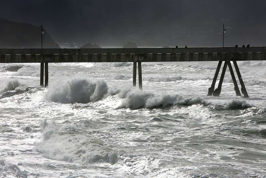 Waves seen at the Pacifica Pier in Pacifica, California, before heavy rains expected this week on Monday, January 4, 2016. Photo: Liz Hafalia, The Chronicle
