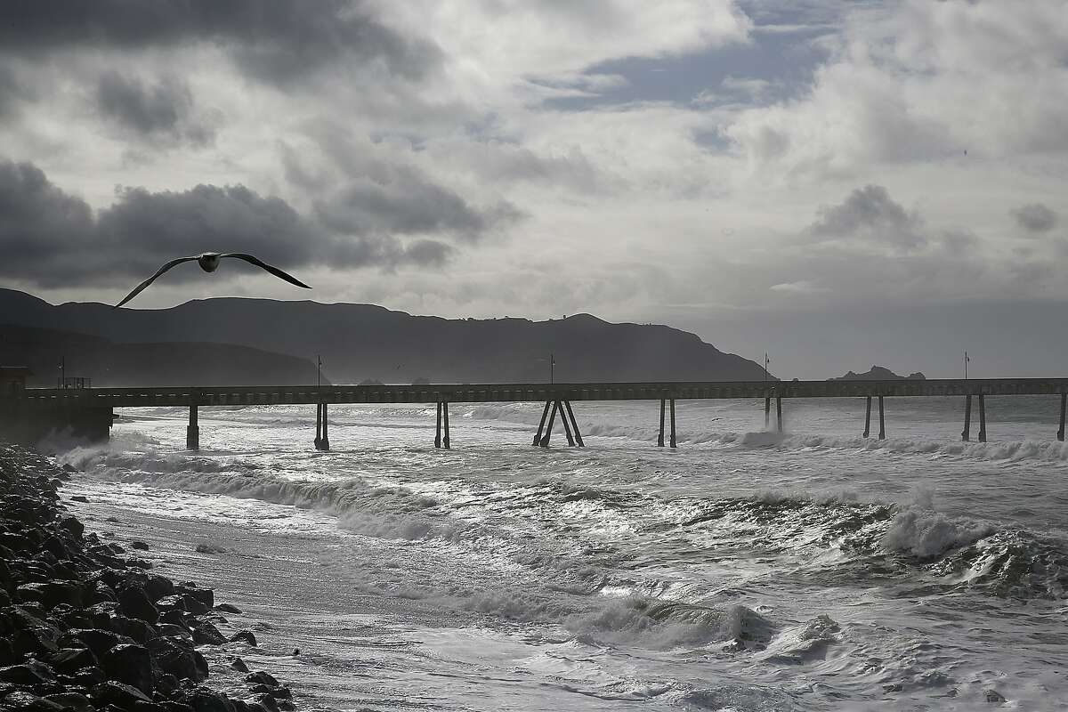 In this file photo, cloudy skies seen at the Pacifica Pier in Pacifica, California, before heavy rains expected this week.